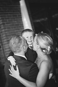 The bride and groom dancing with a little guest! Photo by Molly. #MinneapolisWeddingPhotography