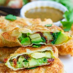 Cheesecake Factory Avocado Egg Rolls Recipe Appetizers with avocado, sun-dried tomatoes, jalapeno chilies, cilantro, lime juice, egg roll wrappers, egg whites, oil, cashew nuts, tamarind concentrate, balsamic vinegar, honey, cilantro, garlic, ginger, chili sauce, salt