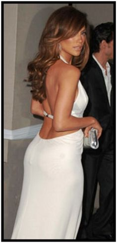 If i'm the color of her dress now, is it OK to get a spray tan for my wedding to be JLo tan?