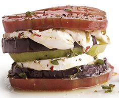 eggplant heirloom tomato and buffalo mozzarella stacks recipe. Fresh mozzarella is great at soaking up flavors; in this recipe it's enlivened by olive oil infused with thyme, marjoram, and lemon. One of the best things about this quick dish is that it works as a light lunch or as an appetizer.