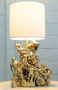 Action figure lamp- glue old action figures to lamp post- primer-paint gold- tada!