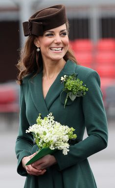 Kate Middleton in St. Patrick's Day green suit, with shamrock corsage - 2013
