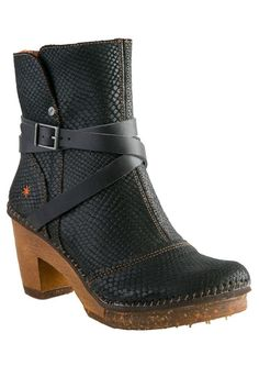 What's not to love about this ankle style boot by The Art Company? Black embossed leather with ankle strap details on a clog base. Perfect heel height for all day wear. The Art Company produces metrop