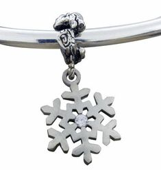 """Frosted Snowflake Bracelet Bead This frosted snowflake is featured in Sterling Silver with a cubic zirconium center stone.  In the winter it becomes apparent that no two snowflakes are alike and at Park City Jewelers the designers like to celebrate the uniqueness of each snowflake. This """"frosted flake"""" is sandblasted to give it the flat finish and one of a kind look. Snowflake Jewelry, Frost, Belly Button Rings, Snowflakes, Beaded Bracelets, Charmed, Jewels, Heavens, Park City"""