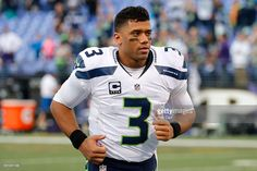 Quarterback Russell Wilson #3 of the Seattle Seahawks runs off the field after defeating the Baltimore Ravens 35-6 at M&T Bank Stadium on December 13, 2015 in Baltimore, Maryland.