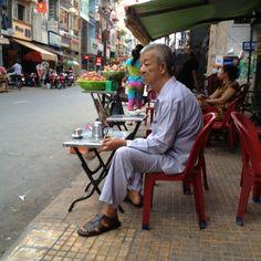 Elderly man with his super strong drip coffee with condensed milk Saigon - Vietnam