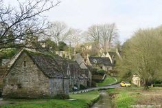 Little yellow car photobombs Arlington Row in Bibury. Deb says to go here.