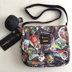 """Tokidoki for LeSportsac Gelatto crossbody Authentic Tokidoki for LeSportsac Gelatto Giramondo crossbody bag with black adjustable straps, magnetic flap closure, with 2 exterior pockets (when you open the bag) and 1 interior pocket, measures approx. 8.5""""wide x 7""""high x 1.5""""deep. Includes puffy keychain as pictured. Brand new with tags. tokidoki Bags Crossbody Bags"""