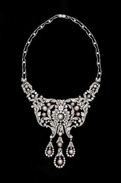 Designed as an openwork cascade of diamonds and pearls, this superb necklace is a masterwork by Dreicer & Company, considered one of the world's finest jewelers from the late nineteenth century until the 1920s