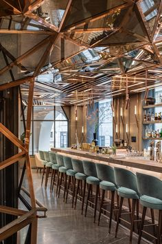 Sculptural staircase clad in glass and copper - Located in the heart of Vienna's Golden Quarter, Gatserelia Designs have developed 'AI Restaurant', an innovative Asian restaurant taking the city by storm with its unique and edgy vibe. #restaurant #interiordesign #vienna #gatsereliadesign
