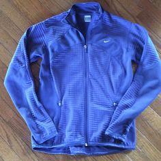 Nike Fit Therma Jacket Nice zippered Nike jacket.  3 pockets on the inside and 2 zippered pockets on the outside.  Fleece on the inside. Nike Jackets & Coats