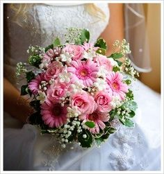 Pink Gerber Daisies,Pink Roses,a white Stephanotis Embellished With Pearls with Phlox and Pittosporum Bouquet