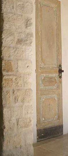 Antique Wood Paneled Door, Stone Wall via Chateau Domingue as seen on linenandlavender.net