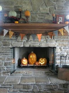 Totally putting pumpkins in my fire place for Halloween..Could also use plain or decorated for Fall pumpkins in place of the carved Halloween pumpkins.