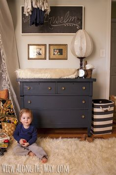 Neutral, vintage nursery for a baby boy. Use a dresser with a sheep skin instead of a changing table. Then you can re-use it as a dresser later.