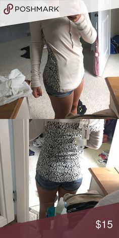 Long sleeve comfortable short Has black and cream lace on the side and back. Never worn before with tags. XS but runs big Andrea jovine Sweaters