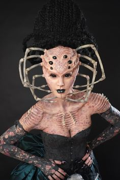 Makeup design/sculpture: Melissa Jimenez Lab work: Jamie Leodones Model/Wardrobe fabrication: Mo Meinhart Application: Jamie Leodones and Melissa Jimenez Headpiece design: Caley Johnson Proudly sponsored by: Cinema Makeup School, Premiere Products Inc, Gfx and Paasche Airbrush.