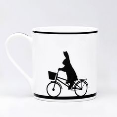 Cycling Rabbit. HAM Rabbit Mug's available from Hus & Hem. (www.husandhem.co.uk) We can't think of a better way to start the day than having your morning brew in one of these fine bone china mugs with their minimal and brilliantly witty designs! Dish washer and microwave safe. Hand decorated in Stoke on Trent.