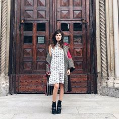 31 Perfect Looks To Copy This October #refinery29  http://www.refinery29.com/october-outfit-of-the-day-ideas#slide-26  You can still wear a floral frock in October. Simply pair it with a statement jacket and some chunkier shoes.Xacus dress, Fendi jacket....