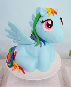 Gorgeous Rainbow Dash cake at a My Little Pony party!  See more party ideas at CatchMyParty.com!  #partyideas #mylittlepony