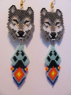 Hand Beaded Grey Wolf dangling earrings with paw and by beadfairy1, $12.95