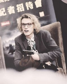 Glasses and tousled hair-  Jamie Campbell Bower