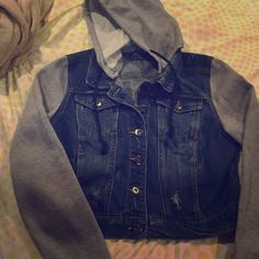 Jean jacket with sweater sleeves and hood Jean jacket with sweater sleeves and hood. Can be worn with or without the hood. Size L and it sits shorter than a usual jacket. Only worn once for a couple of hours so it's basically brand new. Open to trading. Jackets & Coats Jean Jackets