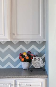 This is another pattern for a vinyl backsplash. Chevron! The real beauty of this, besides the cheapness, is that when chevron isn't as crazy trendy anymore, it comes right down! Really thinking about vinyl instead of a tile backsplash.