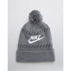 Shop Nike Futura Pom Pom Beanie at ASOS.