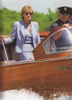 Date updated June 08, 1995: Princess Diana aboard an official police launch boat for the world famous art festival called the Venice Biennale. Princess Diana wearing a light blue skirt suit with narrow black belt, though looks mauve here.