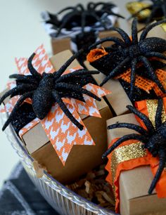 Create these boo-tiful Halloween treat boxes for your party or trick-or-treat guests this year! All you need are someplastic spiders, craft paper boxes and your favorite pairings of Morex ribbons! They are almost too cute to tear open...almost!