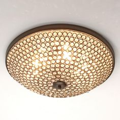 """Sparkling Light Show Flush Mount Light A dazzling lightshow is created when you illuminate this sparkling flush mount ceiling light. Rings of metal in your choice of Bronze or Polished Chrome finish, suspend hundreds of clear beveled crystal beads to catch the light from six interior bulbs. ( 19""""W x 5.5""""H ). 6-40 watt bulbs includedSKU: FM13052 BZ Price:  $460.00"""