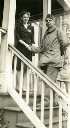 Hostess welcomes U.S soldiers at the John Marshall House, in Richmond, VA. 1943.