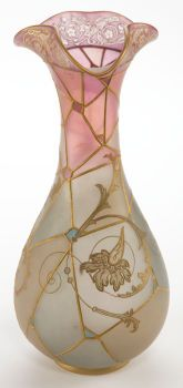A MOUNT WASHINGTON ROYAL FLEMISH GLASS  VASE  Mount Washington Glass Company, New Bedford, Massachusetts, circa  1900  Unmarked  14-1/2 inches high (36.8 cm)    The rose to blue glass vase with gilt geometric design with dragon  and trefoil lip.            Mount Washington Glass Company:.