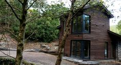 a house in the woods, in the Snowdonia National Park House In The Woods, My House, Snowdonia National Park, Garden Design, House Design, Cheap Air, National Parks, Architecture, House Styles