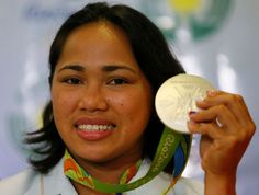 Seven biggest surprises of the 2016 Summer Olympic Games:     4. Philippines ends 20-year medal drought as Hidilyn Diaz makes history  -  August 12, 2016   -      Hidilyn Diaz, who won Silver in the women's 53-kg Weightlifting in the Rio Olympics displays her medal shortly upon arrival Thursday, Aug. 11, 2016, at the Ninoy Aquino International Airport in suburban Pasay city south of Manila, Philippines. The medal was the highest and the first for the Philippines in 20 years.