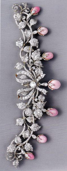 An antique bodice ornament, by Tiffany & Co., circa 1890-95. Composed of platinum, gold, diamonds and conch pearls.