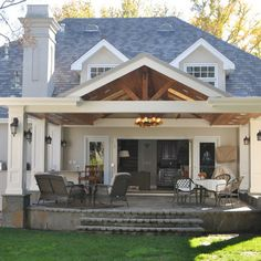 I like the idea of columns on the side of the porch instead of in the front!