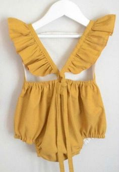 This mustard yellow romper has ruffles and lace on the front and has a great vintage feel. Only Size : 24 Months is Ready To Ship