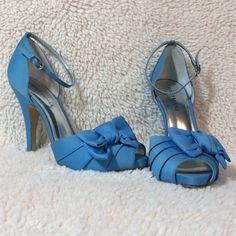 Audrey Brooke Cornflower Blue Heels. Audrey Brooke Cornflower Blue Heels.   Ankle strap. Heel height is 4 1/2 inches. Pretty bows. Peep toe. Silver buckles. Audrey Brooke Shoes Heels