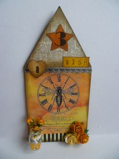 Bee house using papers and image from The Gecko Galz
