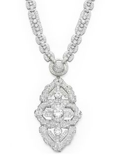 A DIAMOND SAUTOIR   Suspending a detachable openwork circular and single-cut diamond geometric pendant, centering upon three bezel-set circular-cut diamonds, from a pavé-set diamond half boule, within a circular-cut diamond hoop, to the circular-cut and collet-set diamond link neckchain, mounted in white gold, 31 1/8 ins., (may also be worn as a shorter necklace, 24 1/8 ins.; attachment may be worn as a bracelet, 7 ins.; pendant may be worn as a brooch)