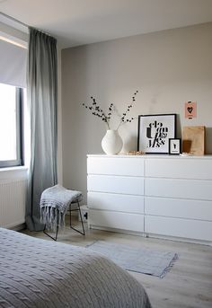Another grey and white bedroom with a hint of pink. Bedroom by Holly Marder