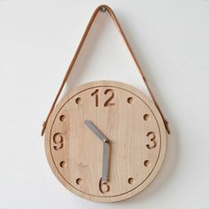 a nice clock for a boy's nursery. love the leather strap detail.