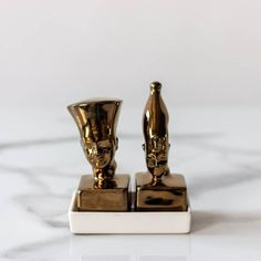 Add a touch of African history to your table setting with the Dynasty Salt & Pepper shakers. Here's a review! See what Nompumelelo had to say about hers - Amazing! The Dynasty Salt and Pepper shakers exceeded my expectations! They are very elegant and make a bold statement on my dinner table. I absolutely love it! Thank you once again Knus.  TAP post to shop🌶️🧂 . . . #knushomedecor #interior #design #interiordesign #interiordecor #interiordecorating #styling #interiorstyling… Interior Styling, Interior Decorating, Interior Design, Salt Pepper Shakers, Salt And Pepper, African History, Online Home Decor Stores, Dinner Table, Candle Holders