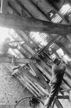 Sniper and observer from the 1/4th Battalion, Royal Berkshire Regiment in the roof of a barn at Antons Farm near Ploegsteert Wood during the spring of 1915.