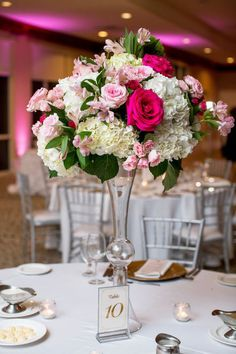 Tall wedding centerpiece idea - pink and white floral centerpiece - See more details on WeddingWire! {Poirier Wedding Photography}