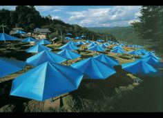 "Christo and Jeanne-Claude   ""The Umbrellas, Japan-USA, Ibaraki, Japan site, 1984-91""   1,340 blue umbrellas in Ibaraki, Japan   1,760 yellow umbrellas in California   Height of each: 6 m (19 ft. 8 in.)   Diameter of each: 8.66 m (28 ft. 6 in.)"