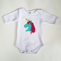 9-month Glammic Onesie White with Unicorn Applique.  Limited Edition.  $35.  Look for more onesies from us in the future!