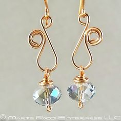 Sapphire Swarovski crystal earring with copper wire vine | http://coolearringscollections.blogspot.com